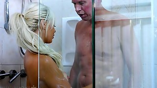 Sexy sitter Elsa Jean gives a blowjob and nuru massage to married man
