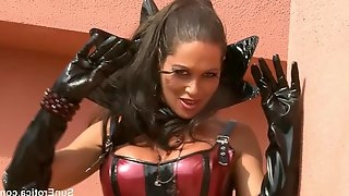 Kinky woman is into corsets, fishnets and leather boots with high heels, while posing for the camera