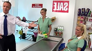 2 milf cashiers with large naturals have threesome in a shop
